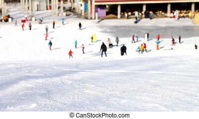 Skiers and snowboarders going down the slope