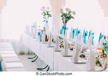 Buautifully decorated banquet table setting with different food and flowers