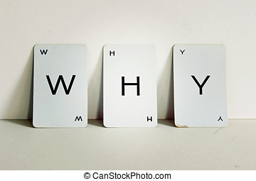 WHY spelled out on three white cards with lens effect