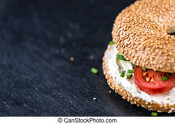 Cream cheese Bagel on a slate slab - Cream cheese Bagel on a...