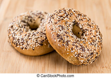 Wholemeal Bagels on wooden background - Wholemeal Bagels...