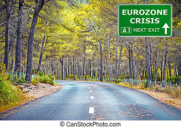 EUROZONE CRISIS road sign against clear blue sky - EUROZONE...
