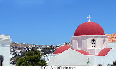 A white church with red roof on Mykonos