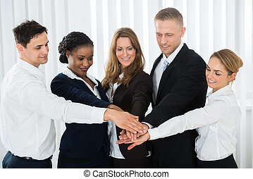 Businesspeople Stacking Hands Over Each Other - Group Of...