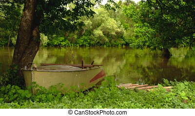 boat moored on the banks of the river - old boat moored on...