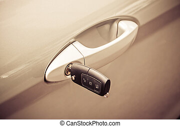 Key with alarm system in the car door