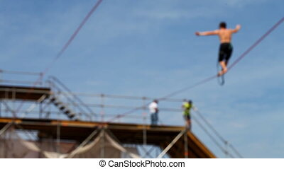 tightrope walking on a high rope stretched Full HD