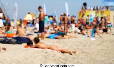 a lot of people are resting on the beach - many people have...