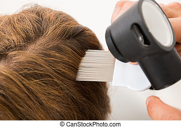Doctor Hand Doing Treatment Of Patient's Hair - Close-up Of...