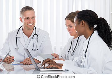 Group Of Doctors In Meeting