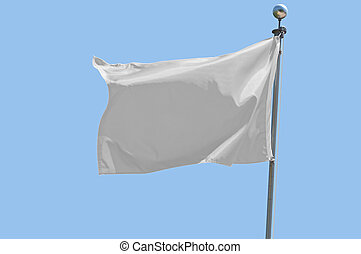 White Flag - White flag flying in a stiff breeze against a...