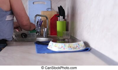 Man Washing Dishes in sink - The Man Washing Dishes in sink