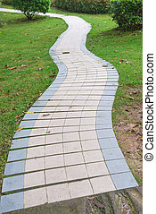 outdoor curved pathway in a garden