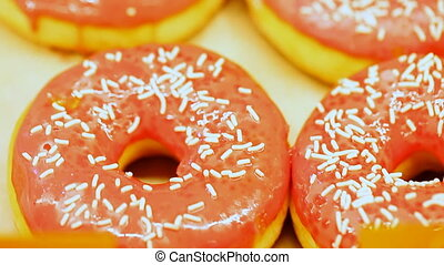sweet donut topped with colored glaze - sweet donut topped...