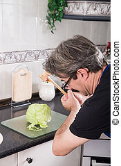 Wrong tool - Guy wanting to use a meat tenderizer to chop...