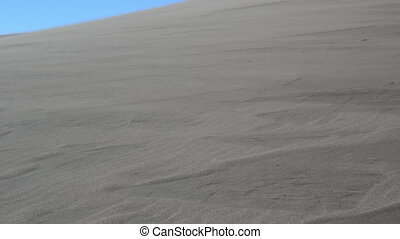 Sand Blows Across A Dune in the Wind - On a windy day, sand...