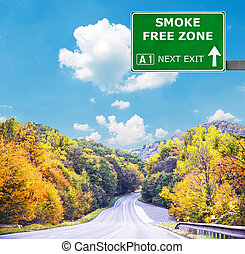SMOKE FREE ZONE road sign against clear blue sky