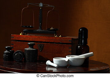 old apothecary tools - old pharmacists stuff, weights,...