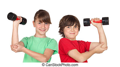 Two children playing sports with weights isolated on white...