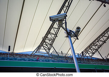 Surveillance cameras controlling playing field and tribunes...