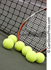 Tennis Balls and Racket - Tennis balls on a racket on the...