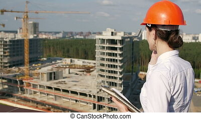 Architect looking on development project - Woman architect...