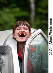 Trapped - Pretty girl is laughing trapped with the car door.