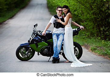 Biker\'s girlfriend - Beautiful smiling couple near...