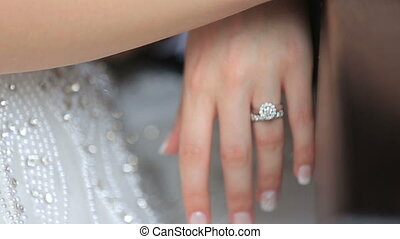 Happy bride and groom hands with golden wedding rings close...