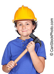 Beautiful child with yellow helmet and hammer