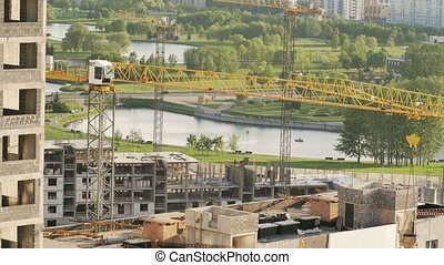view of the construction site with cranes working.