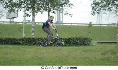 Man riding to the park with smartphone