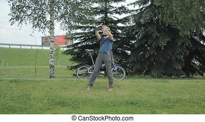 Man making photo with smartphone at park