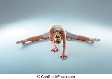 young beautiful dancer warming-up