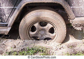 SUV got stuck in the mud, wheel closeup