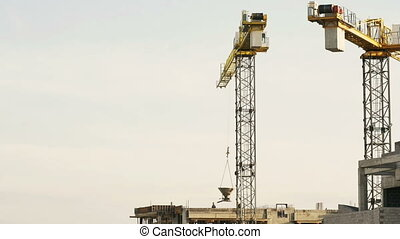 crane lifts the concrete tank on the roof