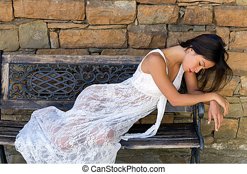Sad beauty dressed in lace gown - Stunning young woman...