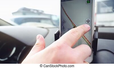 Man use mobile phone in the car, uses the map in slowmotion....