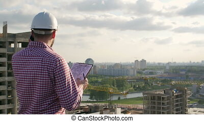Male engineer discusses the project on the phone . - Male...