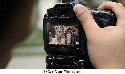 looking on camcorder display during shooting women HD