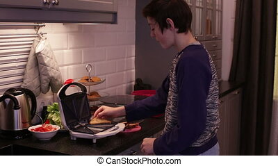 Teenager Boy Cooking Fried Bread