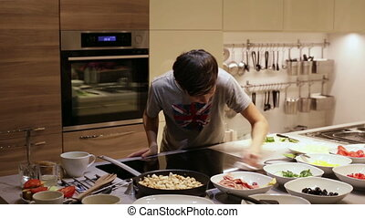 Teenager Boy Clean Electric Stove in the Kitchen - Teen Boy...