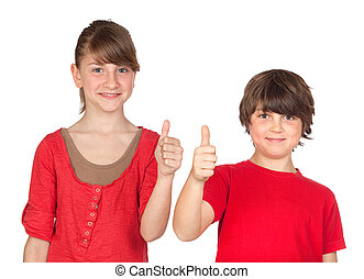 Teenage girl and boy dressed in red saying OK