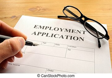 employment application form on desk showing job search...