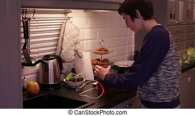Teenager Boy Grinds Coffee in a Coffee Grinder - Teen Boy...