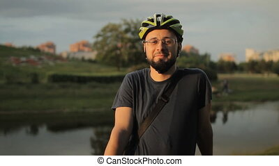 Happy male american cyclist with helmet and bicycle