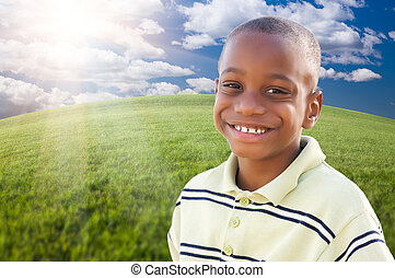 Handsome African American Boy Over Grass and Sky