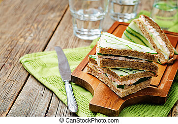 Salmon Greek yogurt cucumber rye sandwiches toning selective...