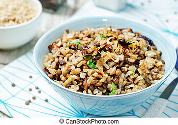 Lentils and rice with Crispy Onions and Parsley. Mujadara....