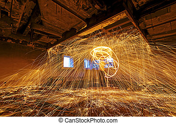 Burning Steel Wool spinning Showers of glowing sparks from...
